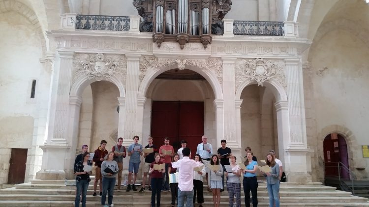 The Choir rehearsing in Pontigny Abbey, conducted by Organ Scholar Viraj