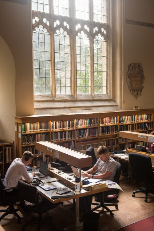 Students studying in the College library