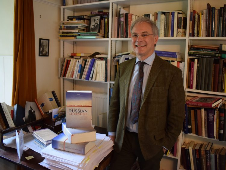 Professor Andrew Kahn, pictured with copies of 'A History of Russian Literature'
