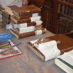 Bandaged books being repaired in the Old Library