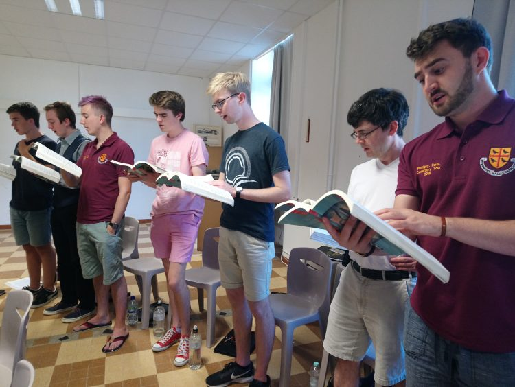 Choir practice during the tour to France
