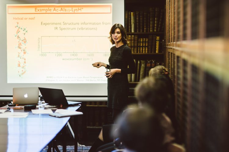 Mariana Rossi giving a Teddy Talk in the Old Library at the 2015 Research Expo
