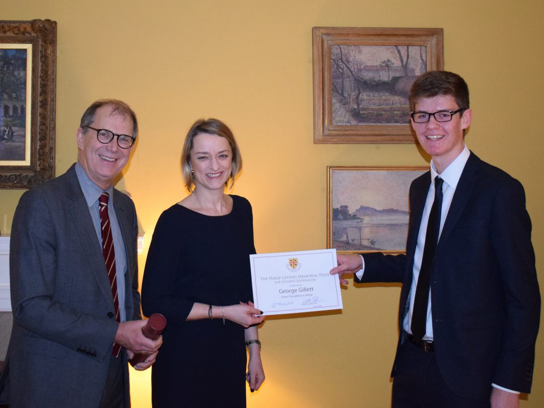 The 2018 Geddes Prize winner, George Gillett, receiving his award from journalist Laura Kuenssberg