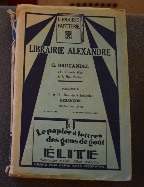 A copy of Le Feu by Henri Barbusse, in custom dust jacket of the book shop from which it was purchased in Besancon