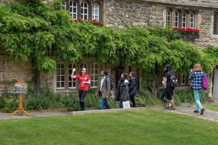 Visitors taking a tour of College with a current student during an Open Day