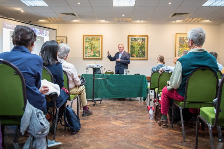 Paul Johnson giving a talk at the St Edmund Hall Research Expo