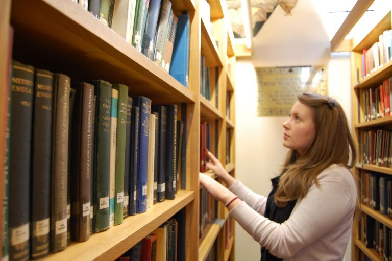 Student searching for book in St Edmund Hall Library