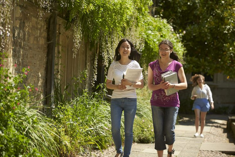 Students walking through the College's Front Quad