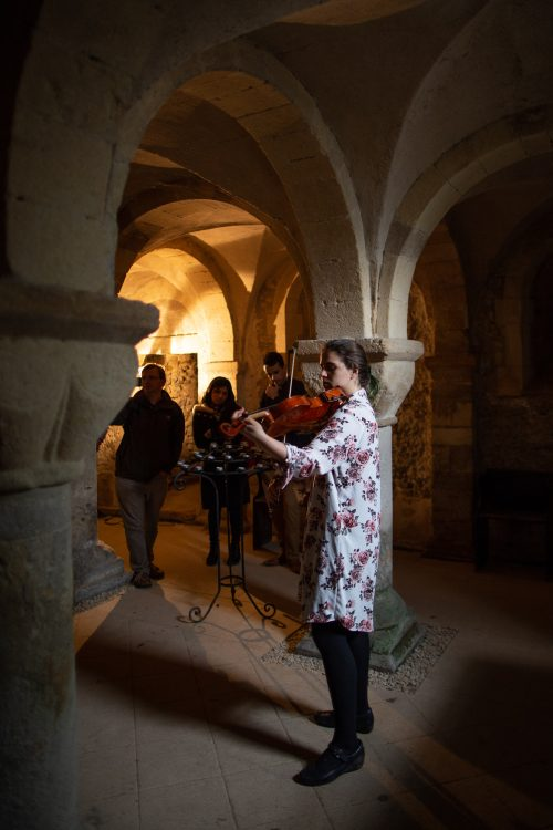 Postgraduate student Andrea Fortier performs a viola recital in the Crypt